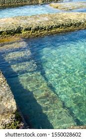 Historical pool by seaside in Malta