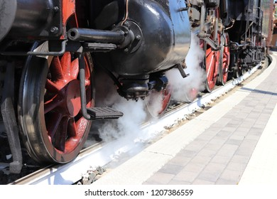 Historical railway line with steam locomotive.