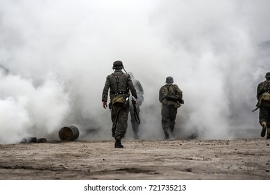 Historical reconstruction of the battle at Arnhem, German soldiers in a cloud of smoke.
