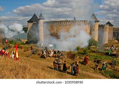 The historical reenactment of Battle of Khotyn (1621) in the old castle of Khotyn (Ukraine, Chernivtsi region). Living history festival. Re-enactors stand in cannon smoke trying to conquer a fortress