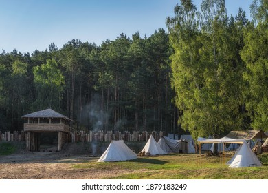 Historical reenactment of Slavic or Vikings tribe encampment with wooden palisade, guard tower, fort and tent camp from 11th century, Cedynia Poland