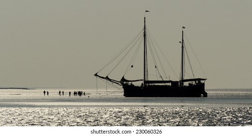 Historical sailing ship during low tide in the North Sea