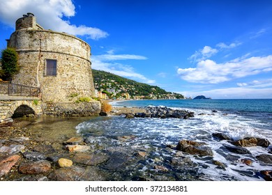 Historical Saracen tower on mediterranean beach in Alassio, popular resort town on italian Riviera, Liguria, Italy