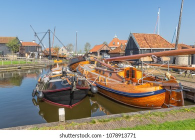 Historical ships and fishing vessels anchored in harbor Dutch fishing village Workum