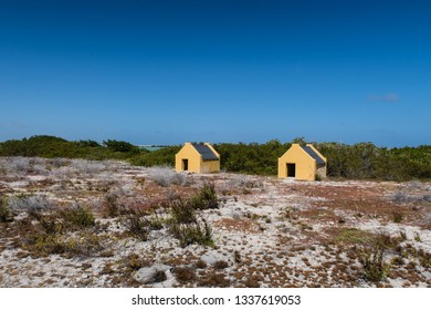 Historical slave huts of the salt mine workers near the salt pan on the tropical island of Bonaire in the Netherlands Antilles