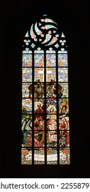 Historical stained glass window with religious scene