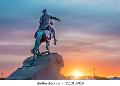"Historical Statue of the monument to Peter 1, Bronze Horseman in Saint-Petersburg at sunset evening sky. Translation: ""To Peter I, Catherine II, 1722 year"""