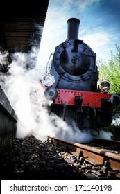 Historical steam engine train in motion
