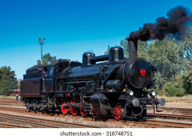 Historical steam train depart from station during celebration