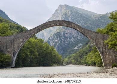 Historical stone bridge of Plaka at Epiros, above Arahtos river