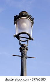 historical street lamp and day sky