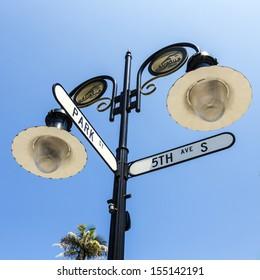 historical street sign in Naples, Florida under blue sky