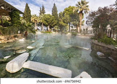 Historical thermal pool with roman ruins in Pamukkale, Turkey.