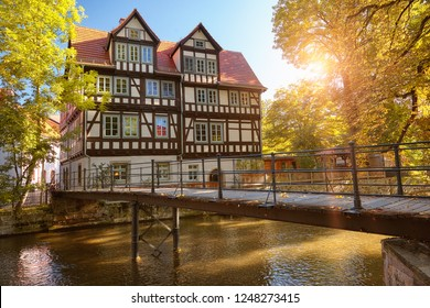 Historical timber house by Gera river in Erfurt, main city of Thuringia, on a quiet afternoon in Autumn