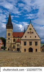 Historical town square in city Bardejov with old city hall and church on beautiful summer sunny day