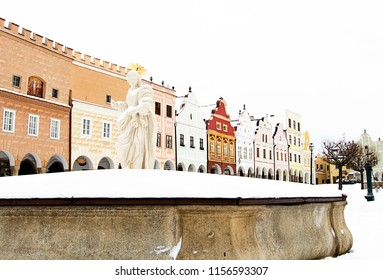 The historical town Telc in winter. Renaissance style houses on the Zacharias from Hradec' s square from the15th cent., Fountain with statue of St. Markete in the foreground, UNESCO, Czech Republic