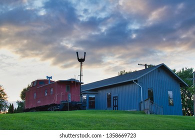 The historical train depot in Topeka, Indiana built in 1911 with an evening sky.