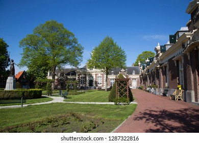 Historical village square with old  shelter or retire home for sailors, named 'Asylum for Old and flawed Sailors'