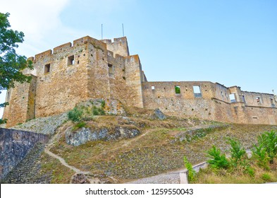 Historical walls of the Convent of Christ complex in Tomar, Portugal. Originally a Templar stronghold from 12th century. The convent complex is a historic and cultural monument listed as UNESCO WH.
