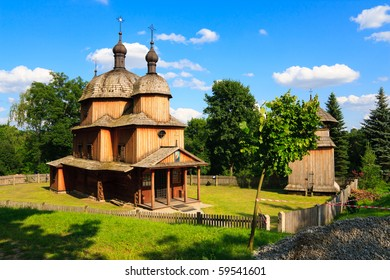 Historical wooden church in polish heritage park. Blue sky and clouds in a background.
