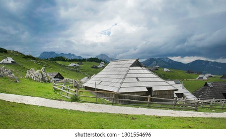 Historical wooden huts on Big pasture plateau in Slovenian Alps.