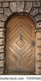 Historical Wooden Plank Door with Arcs in Stone Entry, Prague, The Czech Republic, Europe