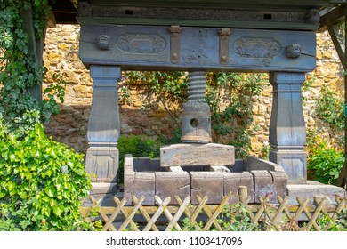 Historical wooden wine press in the garden on a sunny day
