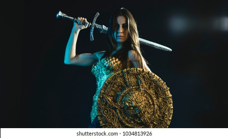 History valkyrie warrior, woman with golden armor iron coat and big warrior sword