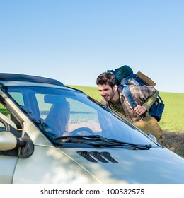 Hitch-hiking getting lift young woman in car road trip