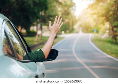 Hitchhiking man.tourist hitchhiking sitting in the car on the road.Travel on vacation