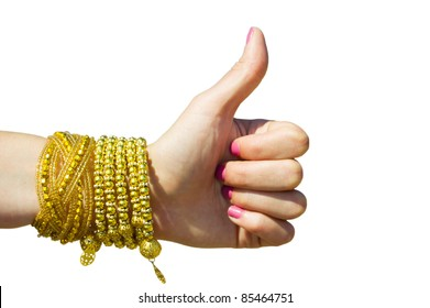 hitchhiking, thumbs up female hand, for praise or like hand gestures. Isolated on white. Female hand with pink manicure and yellow gold bracelets