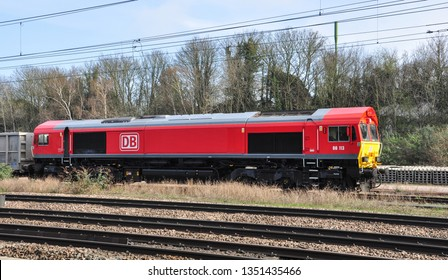 HITCHIN, HERTFORDSHIRE/UK - March 26, 2019. DB Class 66 diesel loco with freight in sidings at Hitchin, Hertfordshire, England