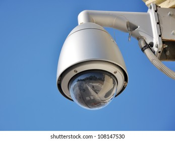 Hi-tech dome type camera and a blue sky