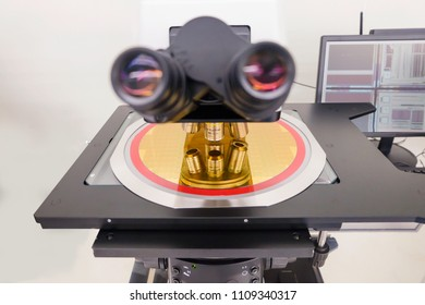 hi-tech industry:a silicon wafers place on microscope machine for examination in die Daf attach check thickness and angle measurement in clean room, image not focus, in a semiconductor manufacturing,