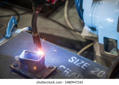 The hi-technology additive material processing by robotics arm. The robotic arm welding the metal parts.