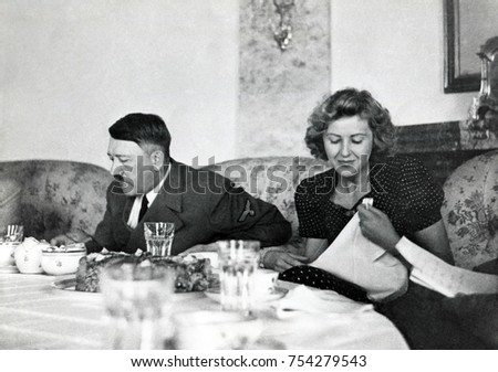 Hitler and Ava Braun at dining table at Berchtesgaden, ca. 1937-1943. Braun was the hostess at informal gatherings, but hidden away when high officials visited the Bavarian retreat.