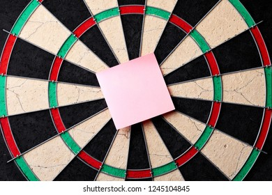 Hitting in the target center of dartboard. Targeting the business concept. Bullseye of a Dartboard.
