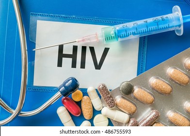 HIV disease concept. Many pills and drugs around.