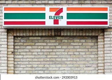 Hjorring, Denmark - June 28, 2015: 7 eleven logo on a facade. 7-Eleven is an international chain of convenience stores that operates primarily as a franchise