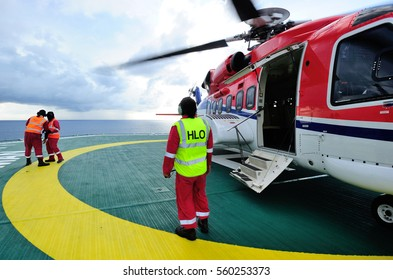 A HLO, helicopter landing officer, on duty on the offshore helipad