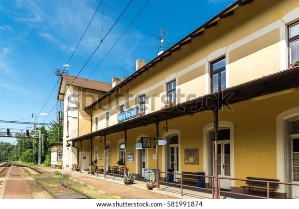 HLUBOKA NAD VLTAVOU, CZECH REPUBLIC - 4 august 2016: Railway station Hluboka nad Vltavou-Zamosti. The building is a classic Czech railway station, passenger platform.