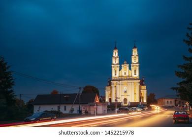 Hlybokaye Or Glubokoye, Vitebsk Region, Belarus. Church Of Sts. Trinity In Evening Night Lighting. Night View