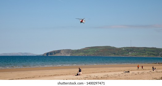 HM Coastguard Rescue Helicopter flies low over Benllech beach, Isle of Anglesey, North Wales, United Kingdom, Europe on Sunday, 12th, May, 2019