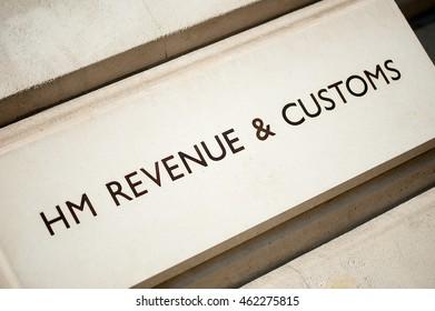 HM Revenue & Customs sign on building.