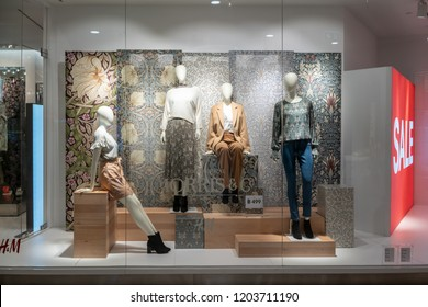 H&M shop at Emquatier, Bangkok, Thailand, Oct 15, 2018 : Unique H&M clothing with Morris & Co collaboration  window display for autumn collection.