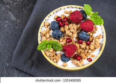 Hmemade healthy brunch or breakfast bowl, top view on granite table.