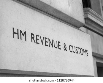 HMRC (Her Majesty Revenue and Customs) sign in London, UK in black and white