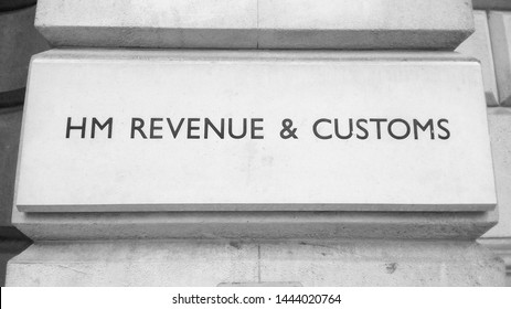 HMRC Her Majesty Revenue and Customs sign in London, UK in black and white