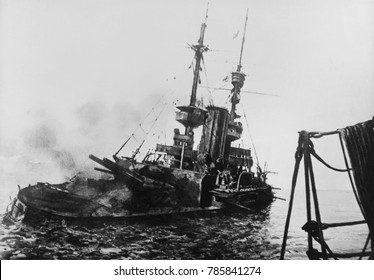 HMS IRRESISTIBLE listing and sinking in the Dardanelles, March 18, 1915. The ship hit a mine while shelling Turkish defenses. Photograph taken from the battleship HMS LORD NELSON