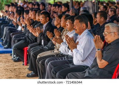 Hnong Main Ngam, Thailand - December 04, 2014: People pray during a public funeral ceremony in rural Thailand.